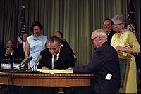 Former president Truman and wife Bess at Medicare Bill signing in 1965, as Lady Bird and Hubert Humphrey look on