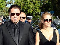 Travolta with wife Kelly Preston at the 2014 Cannes Film Festival