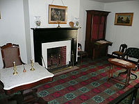 Parlor of the (reconstructed) McLean House, the site of Confederate General Robert E. Lee's surrender. Lee sat at the marble-topped table on the left, Lieutenant General Ulysses S. Grant at the table on the right