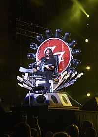 Grohl performing with a broken leg at Fenway Park in July 2015
