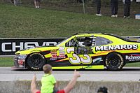 Fans waving to Menard, celebrating his third Xfinity Series win at Road America.