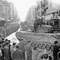 British tank moves through Tunis during the liberation, 8 May 1943