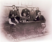 Edison with perfected phonograph and those who worked on it. Edison is seated, center; Wangemann is standing behind him.