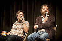 Marc Maron (left) and Zach Galifianakis (right) participating in a Doug Loves Movies podcast at the 2012 Los Angeles Podcast Festival