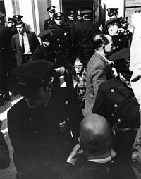 Morgan being arrested at Grove Press, 1970