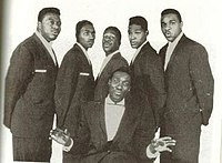A 1959 promotional picture of Harvey and the New Moonglows. Gaye is second from the right behind a seated Fuqua.