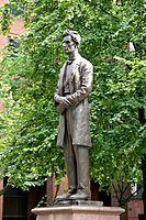 Statue of Lincoln in Manchester, with extracts from the working men's letter and his reply on its base.