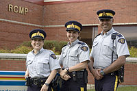 Royal Canadian Mounted Police officers in St. Albert. The RCMP provides municipal policing throughout most of Alberta.