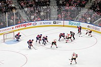 An ice hockey game between the Calgary Flames, and the Edmonton Oilers, two teams in the National Hockey League