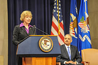 Baldwin speaking at a U.S. Department of Justice event.