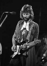 English guitarist, singer, and songwriter Eric Clapton is the only three-time inductee to the Rock and Roll Hall of Fame