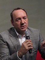 Spacey speaking at a press conference in Singapore, 2010