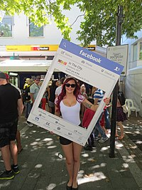 Human billboard advertising Facebook Canberra in the City page at the National Multicultural Festival