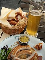 Bavarian Bratwurst with mustard, a pretzel and beer