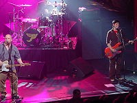 Pixies in concert in Kansas City, October 1, 2004. From left to right, Frank Black, David Lovering (back) and Kim Deal.