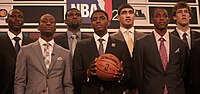 Irving (center) at the 2011 NBA Draft with other draftees