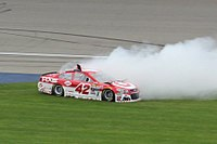 Kyle Larson pulls a burnout following his first career Cup win in the Pure Michigan 400 at Michigan International Speedway