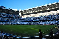 Real Madrid fans displaying the white of their club before El Clásico. Real Madrid fans also often wave Spanish flags at El Clásico games.