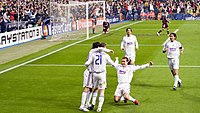 Real Madrid players celebrating a goal against Bayern Munich in 2007