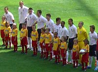 Ferdinand (wearing No.5) lining up for England against Paraguay at the 2006 FIFA World Cup.