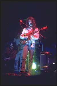 Van Vliet seated left on stage with Zappa in 1975