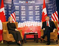 Harper and US Secretary of State Hillary Clinton at the Haiti Ministerial Preparatory Conference addressing earthquake relief in Montreal, January 25, 2010