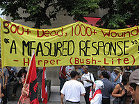 A banner criticizing Harper's response to the 2006 Israel–Lebanon conflict, Toronto
