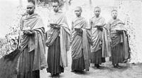 Buddhist monks from Nepal. According to the earliest sources, the Buddha looked like a typical shaved man from northeast India.
