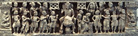 """The """"Great Departure"""" of Siddhartha Gautama, surrounded by a halo, he is accompanied by numerous guards and devata who have come to pay homage; Gandhara, Kushan period"""
