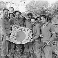 Royal Scots with a captured Japanese Hinomaru Yosegaki flag, Burma, 1945