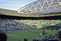Centre Court with open roof at the 2010 Championships