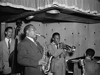 Parker with (from left to right) Tommy Potter, Max Roach, Miles Davis, and Duke Jordan, at the Three Deuces, New York, circa 1945
