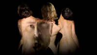 Screenshot from the music video, in which Timberlake's face is projected on the women's nude bodies