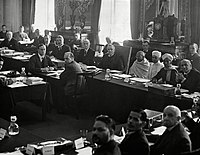 """British prime minister, Ramsay MacDonald, to the right of Gandhi at the 2nd Round Table Conference. Foreground, fourth from left, is B. R. Ambedkar representing the """"Depressed Classes"""""""