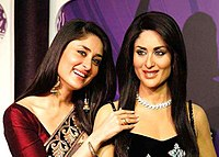 Kapoor with her wax sculpture at Madame Tussauds. As one of her most distinctive physical features, Kapoor's lips have been identified by the Indian media as her trademark.