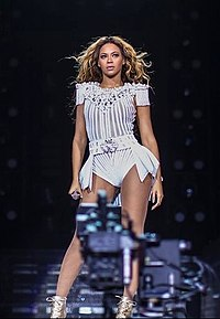 Beyoncé performing during The Mrs. Carter Show World Tour in 2013. The tour is one of the highest grossing tours of the decade.