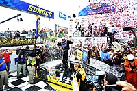 Stewart celebrating his win of the 2013 FedEx 400