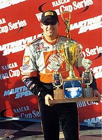 Stewart holding the trophy after his victory at the 2000 NAPA Autocare 500