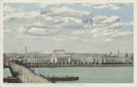 The then-new Cambridge campus, completed in 1916. The Harvard Bridge (named after John Harvard but otherwise unrelated to Harvard University) is in the foreground, connecting Boston to Cambridge.