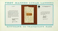 Pieces of fabric and wood from the first airplane, the 1903 Wright Flyer, traveled to the Moon in the lunar module and are displayed at the Wright Brothers National Memorial