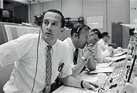 CAPCOM Charles Duke (left), with backup crewmen Jim Lovell and Fred Haise listening in during Apollo 11's descent