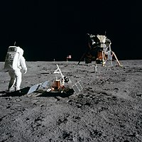 Aldrin next to the Passive Seismic Experiment Package with Eagle in the background