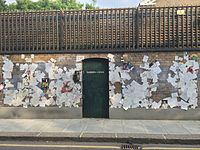 The outer walls of Mercury's final home, Garden Lodge, 1 Logan Place, West London, became a shrine to the late singer