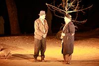 Beckett's Waiting for Godot is considered a hallmark of the Theatre of the Absurd. The play's two protagonists, Vladimir and Estragon (pictured, in a 2010 production at The Doon School, India), give voice to Beckett's existentialism.