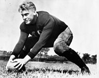 Ford during practice as a center on the University of Michigan Wolverines football team, 1933