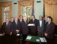 The Warren Commission (Ford 4th from left) presents its report to President Johnson. (1964)