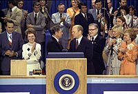 Governor Ronald Reagan congratulates President Ford after the president successfully wins the 1976 Republican nomination, while Bob Dole, Nancy Reagan, and Nelson Rockefeller look on.