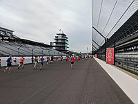 Participants in the OneAmerica 500 Festival Mini-Marathon reaching the Indianapolis Motor Speedway in 2018.