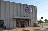 USAC headquarters in Speedway, Indiana in 2016. The building was located on 16th Street, less than a block from the Indianapolis Motor Speedway (track is visible behind).