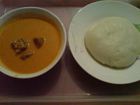A plate of fufu (right) accompanied with peanut soup